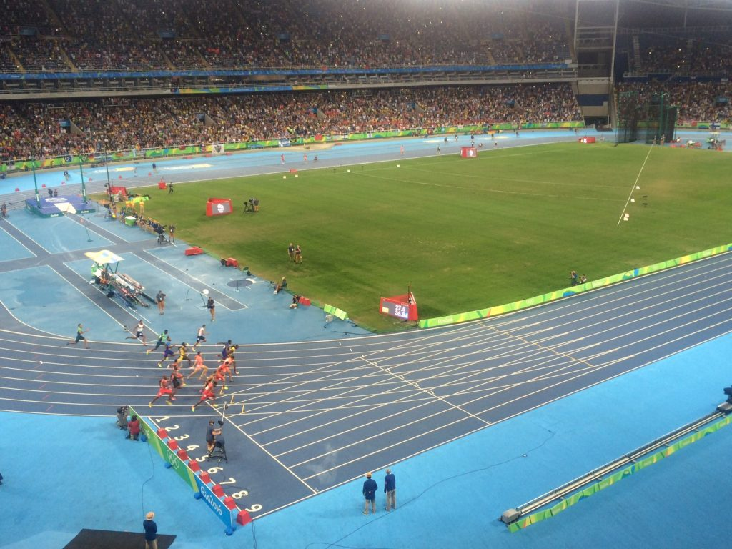 Bolt on his way to 4x100 Gold